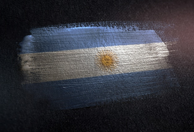 Argentina flag made of metallic brush paint on grunge dark wall