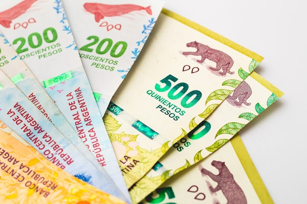 Argentina money banknotes on a white surface in close up photography