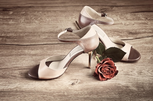 Argentine tango shoes with a rose on wood