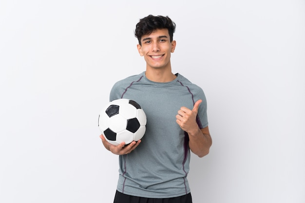 Argentinian football player man over isolated white wall with thumbs up because something good has happened