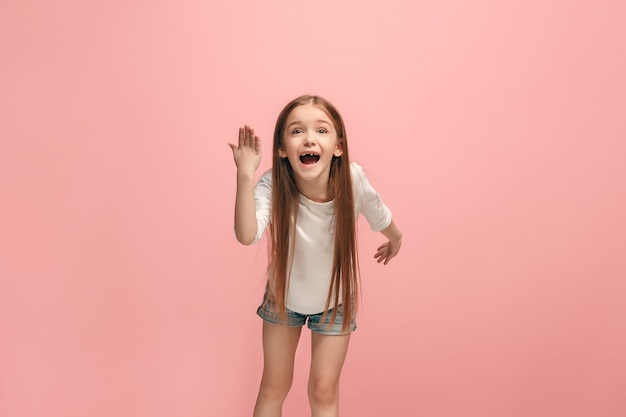 Argue, arguing concept. beautiful female half-length portrait isolated on pink. young emotional teen girl looking at camera