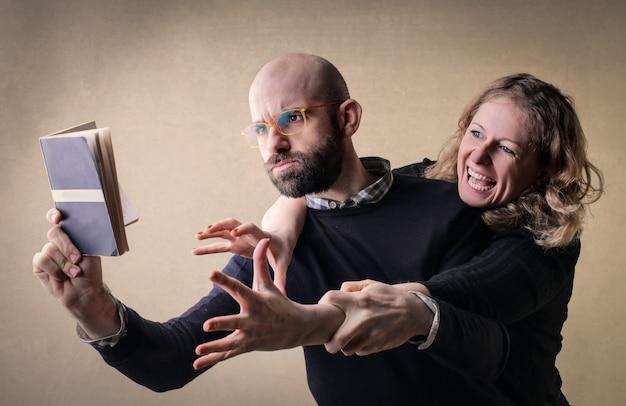 Arguing couple over a book