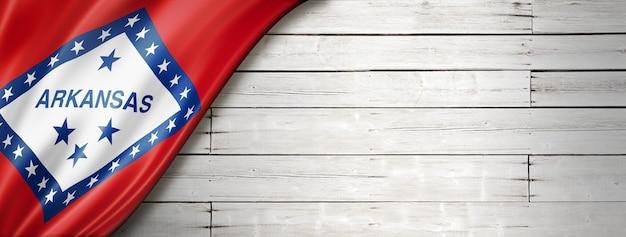 Arkansas flag on white wood wall banner, usa. 3d illustration