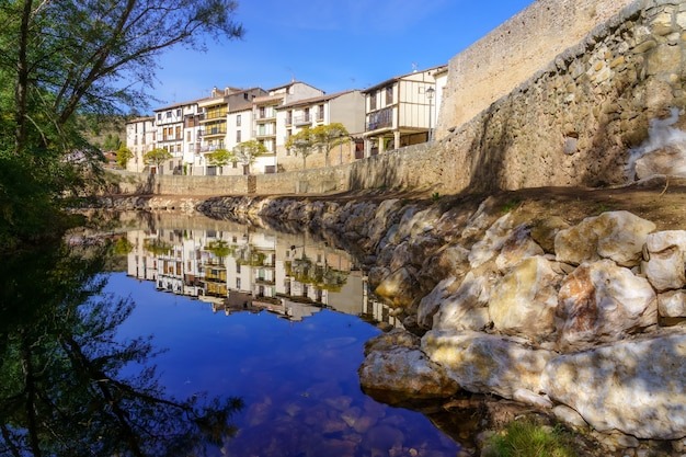 Arlazã³n river as it passes through the town of covarrubias in spain. europe