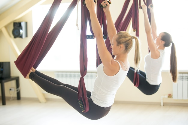 Arm balance practice in hammock