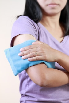 Arm cold or hot therapy woman.