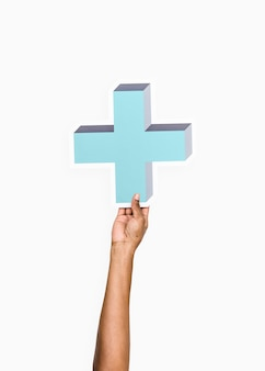 Arm raised and holding blue cross icon