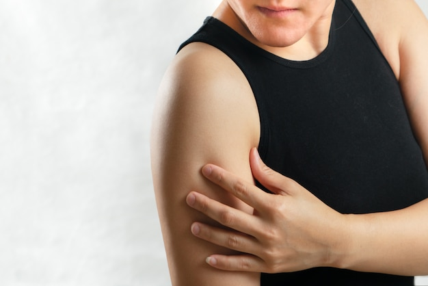 Arm and shoulder pain/injury women with white backgrounds, healthcare and medical concept