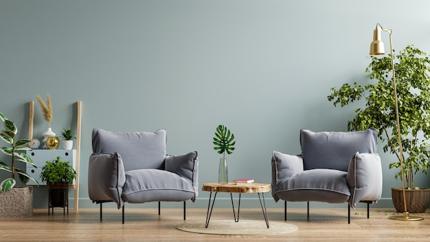 Кресло и деревянный стол в интерьере гостиной с растениями, темно-синяя стена. 3d визуализация