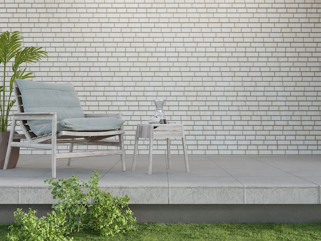 Armchair on concrete floor terrace and empty white brick wall