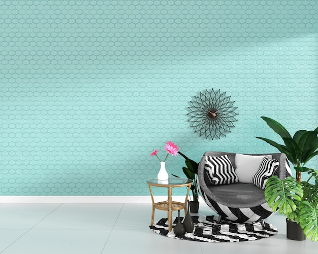 Armchair and green plants on hexagon mint tile texture wall