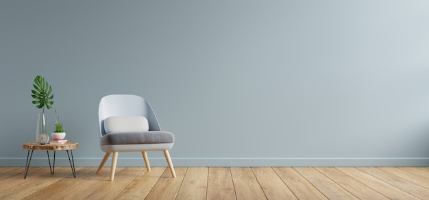 Armchair and wooden table in living room interior,blue wall.3d rendering