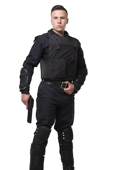Armed special force soldier in black uniform