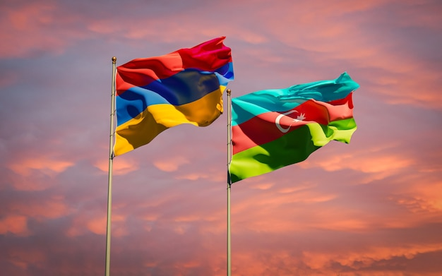 Armenia and azerbaijan flags together waving in the sky background