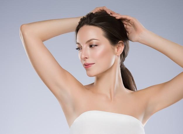 Armpit woman depilation concept hand up clean skin. studio shot.