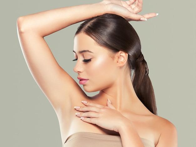 Armpit woman healthy skin depilation concept woman hand up. color bakcground. studio shot.