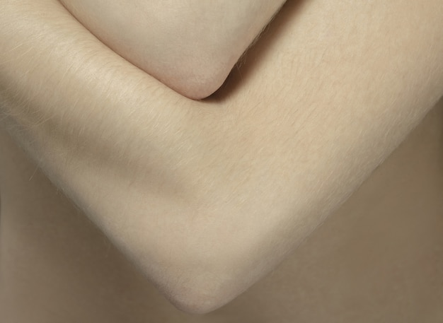 Arms. detailed texture of human skin. close up shot of young caucasian female body.
