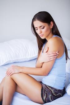 Arms pain. beautiful woman body feeling pain in shoulders