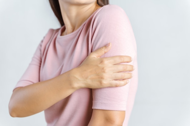 Arms pain. beautiful woman suffering from painful feeling in arm muscles. healthcare and medical concept.