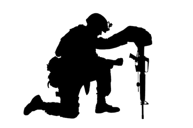 Army soldier in sorrow for fallen comrade standing on knee dog tags on chain studio shoot isolated on white low key silhouette military funeral honors grief for killed in action