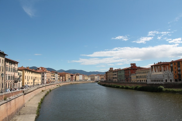 Arno river pisa italy with a clear blue sky