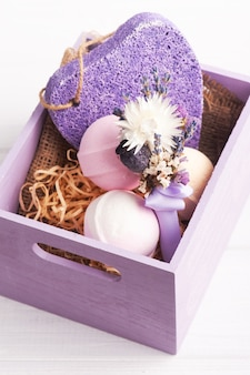 Aroma bath bombs, purple pumice and lavender in spa arrangement in wooden box