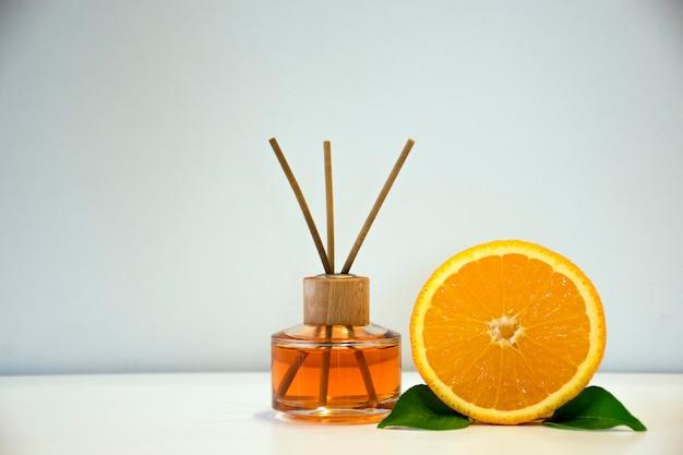 Aroma diffuser and orange citrus fruit.