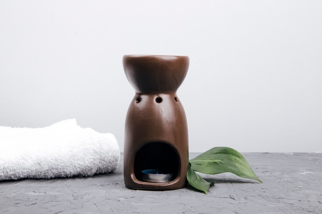 Aroma lamp on a concrete background