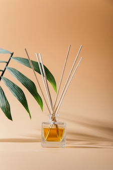 Aroma liquid in glass bottle with sticks