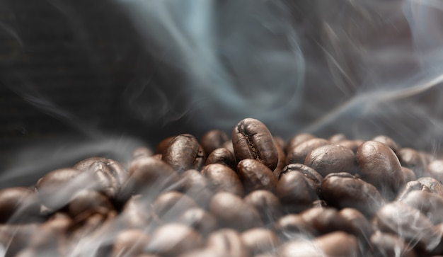 Aroma roasted coffee beans with smoke rising