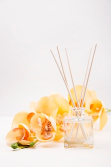 Aroma sticks in glass on a white background