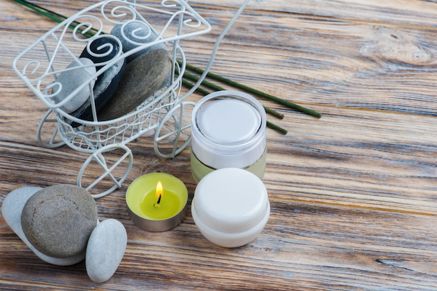 Aroma sticks, pebbles and lit candle