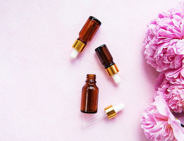 Aromatherapy essentials oils and pink peonies