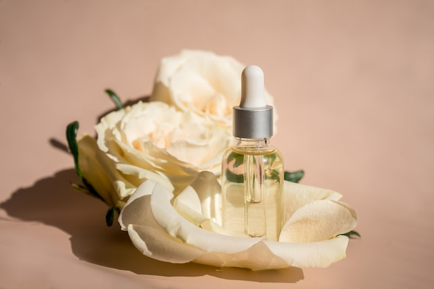 Aromatherapy. white blossom and petals, rose essential oil in glass bottle. . high quality photo