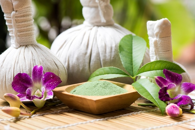 Aromatherapy with green tea and herbal ball on nature background.