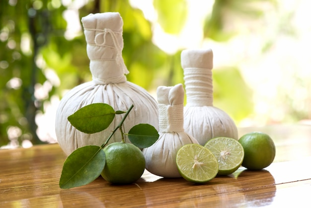 Aromatherapy with lemon fruits and herbal ball on nature background.