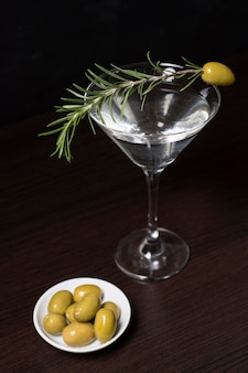 Aromatic cocktail with rosemary and olives