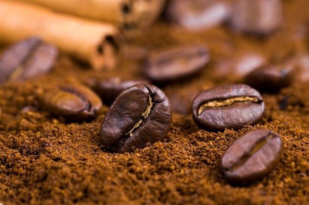 Aromatic coffee beans during the preparation of the drink, delicious and fragrant whole coffee beans on the surface, closeup