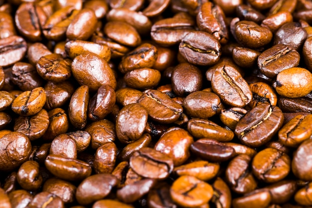 Aromatic coffee beans during the preparation of the drink, delicious and fragrant whole coffee beans on the surface