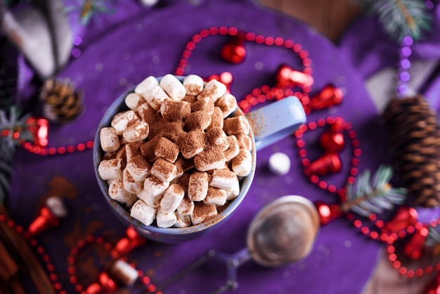 Aromatic coffee with marshmallow sprinkled with cocoa, new year's and festive dessert and a drink.