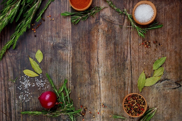 Aromatic dry herbs and spices on wooden table. top view.