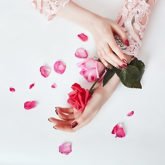 Aromatic flowers in her hand.