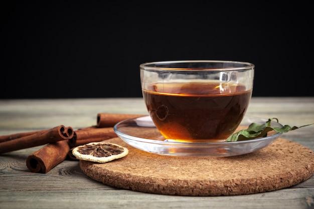 Aromatic hot cinnamon tea on wooden table