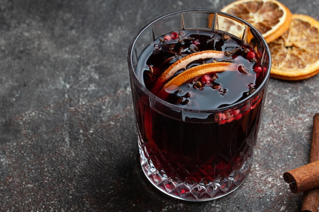 Aromatic mulled red wine on grey table