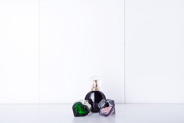 Aromatic perfume bottles on a shelf in the bathroom, copy space