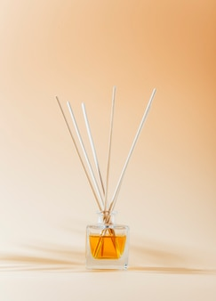Aromatic reed diffuser glass bottle on a light background