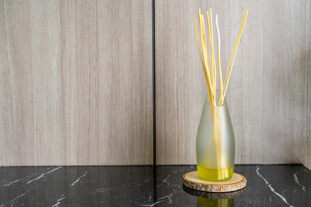 Aromatic reed freshener on table in a room