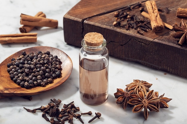 Aromatic seeds essential oil on glass bottle