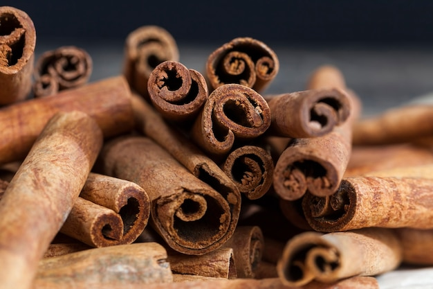 Aromatic solid cinnamon used to make aromatic and delicious spices for baking rolls and cooking other dishes, close-up of whole cinnamon sticks