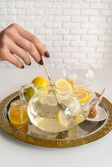 Aromatic tea with lemon on table